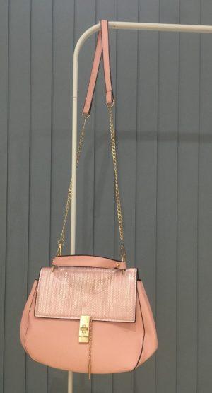 Pink over the shoulder bag